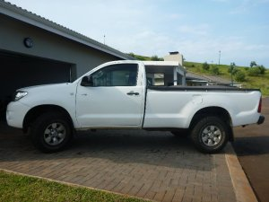 "For my non-SA readers, this is a bakkie, which you may know as a pickup truck. Pronounced ""bucky"", not ""backy"". On Hurley's planet of Umayma, the bakkies run on cockroaches."